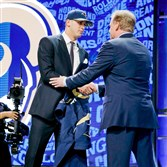 Jared Goff, left, receives the handshake of a lifetime from NFL commissioner Roger Goodell after being selected No. 1 overall by the Los Angeles Rams Thursday night in Chicago.