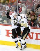 Penguins' Chris Kunitz leaps with joy after scoring the game winner against the Capitals in the third period at the Verizon Center Washington, D.C.