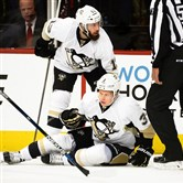 Olli Maatta has trouble getting up after big hit by Capitals defenseman Brooks Orpik in the first period of Game 2 of the Eastern Conference semifinals Saturday at Verizon Center in Washington.