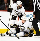 Penguins defenseman Olli Maatta (right) was assisted by center Nick Bonino during the first period. Maatta was injured when he was struck in the head by Capitals defenseman Brooks Orpik during Game 2 of their second round playoff series in Washington's Verizon Center on Saturday.