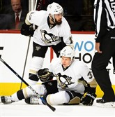 Penguins defenseman Olli Maatta, right, is attended to by center Nick Bonino in Game 2 of their second round playoff series against the Capitals Saturday. Maatta was injured after a high hit by Capitals defenseman Brooks Orpik.