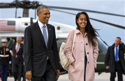 In this Thursday, April 7, 2016 file photo, President Barack Obama jokes with his daughter Malia Obama as they walk to board Air Force One from the Marine One helicopter, as they leave Chicago en route to Los Angeles.