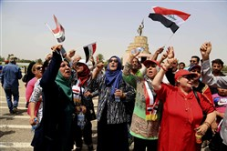 Protesters and supporters of Shiite cleric Muqtada al-Sadr chant slogans Sunday in Baghdad's highly fortified Green Zone, calling for governmental overhauls as they wave national flags before ending their sit-in.