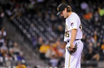 Pirates starting pitcher Gerrit Cole waits as manager Clint Hurdle leaves the dugout to take him out of the game against the Cubs Monday in the fifth inning at PNC Park.
