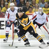 Derrick Pouliot skates up the ice during a playoff game in May season against the Capitals.