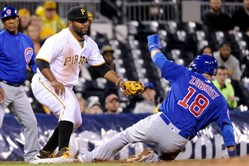The Cubs' Ben Zobrist gets into third base safely Monday against the Pirates' Jason Rogers in the seventh inning at PNC Park.