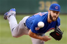 Jake Arrieta delivers Tuesday night against the Pirates at PNC Park.