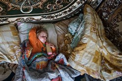 Viktoria Vetrova's 1-year-old daughter suffers from an enlarged thyroid, believed to be caused by radioactivity. They've been eating irradiated locally grown food since the cash-strapped Ukrainian government last year canceled the school lunch program — the only source of clean food in their village of near Chernobyl.