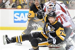 Game 4 hero Patric Hornqvist gets tangled with Capitals goalie Braden Holtby.