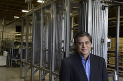 "Lalit Chordia, CEO of  Thar Process Inc., stands in front of the  ""vessels"" of one of the larger ""Super Critical Extraction"" equipment that is made for an order."