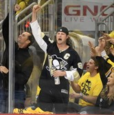 Pirates pitcher Gerrit Cole cheers on the Penguins Wednesday night at Consol Energy Center.