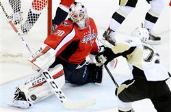 Capitals goaltender Braden Holtby makes a save on Penguins' Patric Hornqvist in the second period of Game 5 Saturday night.