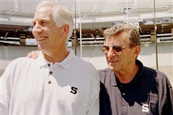 In this Aug. 6, 1999 file photo, Penn State head football coach Joe Paterno, right, poses with his defensi