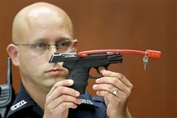 Who wants a piece? The gun used to kill Trayvon Martin, shown during the Florida trial of l of George Zimmerman in 2013.