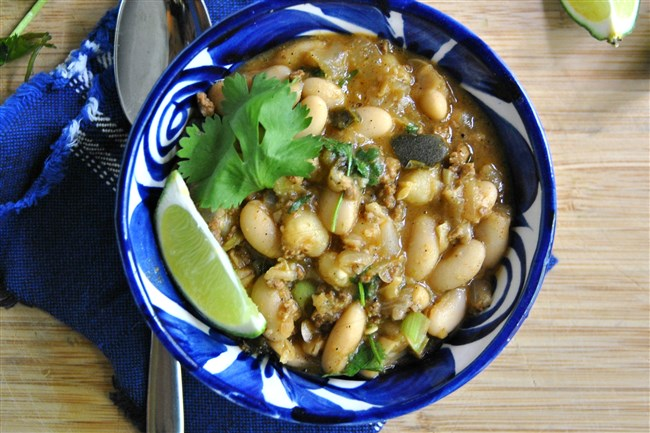 Versatile cannellini beans, vegetarian chipotle sausage and poblano chilies enliven White Bean and Hominy Chili.