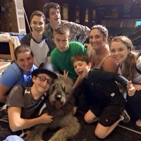 "Members of the cast of Woodland Hills High School's ""Peter Pan"" relaxes with Nana, the dog."