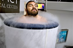 Steelers Cam Heyward stands in a cylinder  with cold steamy effects of liquid nitrogen, for three minutes.
