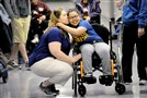 Jamie Englert, 37, of Greenfield kisses her daughter Reese Randolph, 9, prior to the wheelchair race in the 43rd annual Special Olympics Allegheny County Summer Games on Saturday at Baldwin High School.