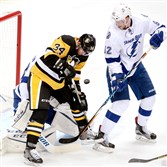 Penguins' Tom Kuhnhackl can't get control of the puck against Lightning goaltender Andrei Vasilevskiy and Andrej Sustr in the second period of Game 1 of the Eastern Conference final Friday at Consol Energy Center.