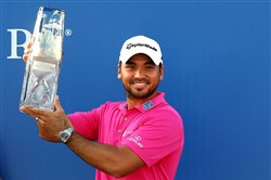 Jason Day holds his trophy after winning The Players Championship Sunday at TPC Sawgrass Stadium Course in Ponte Vedra Beach, Fla.