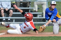 North Hills' Damian Yenzi slides safely into third base against Canon-McMillan's Matt Mish in a Class AAAA first-round game Monday.