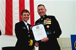 Deputy Commandant for Aviation, U.S. Marine Corps Lieutenant General Jon M. Davis  presents Rear Admiral C.J. Jaynes with her retirement certificate during a ceremony April 1 at Naval Air Station Patuxent River, Md.