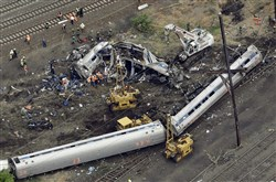 In this Wednesday, May 13, 2015 file photo, emergency personnel work at the scene of a derailment in Philadelphia of an Amtrak train headed to New York.
