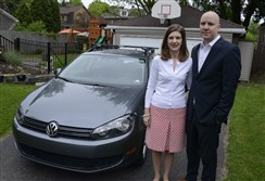 Ann and Tom Ogoreuc stand in their driveway next to their 2012 VW diesel SportWagen.