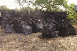This May 12, 2014, file image taken from video by Nigeria's Boko Haram terrorist network shows the alleged missing girls abducted from the northeastern town of Chibok.