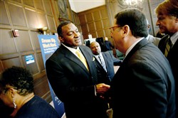 Anthony Hamlet, center, greets Mayor Bill Peduto and Allegheny County County Executive Rich Fitzgerald after being announced as the new Pittsburgh Public Schools Superintendent at a press conference held in Oakland on Wednesday, May 18, 2016.