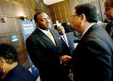 Anthony Hamlet, center, greets Mayor Bill Peduto and County Executive Rich Fitzgerald after being announced as the new Pittsburgh Public Schools superintendent at a news conference in Oakland.