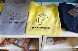 Garbella T-shirts for infants and children are for sale at the new Brambler Boutique in Lawrenceville. Garbella is a Lawrenceville-based company that screen-prints apparel by hand for women, men and babies, along with other accessories.
