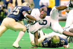 Penn State's Eric McCoo flies into Panthers defensive back Ramon Walker at Three Rivers Stadium in the teams' 2000 meeting, a 12-0 Pitt win.