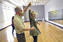 "Walt Rinehart , left, one of the mentors in the ""Yes, You can Dance!"" program, dances the merengue with student Alycia Lazur of Pittsburgh. The classes take place at the Dancexplosion Arts Center."
