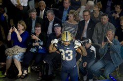 Jordan Whitehead poses during the Pitt script logo unveiling event and fashion show held in the lobby of Petersen Events Center Wednesday in Oakland.