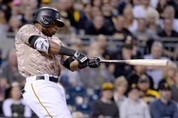 The Pirates' Gregory Polanco hits a triple against the Braves in the fifth inning Thursday at PNC Park.