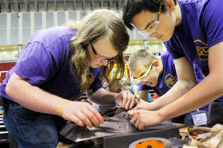 20160521lf-Robot01 Lake Fong/Post-Gazette 05212016 Stephanie Ritenbaugh Local Josh Christman, left, Shawn Cook and Brandon Kostich of Plum Area High School work on their robot prior to the National Robotics League Championship at California University on Saturday, May 21, 2016.