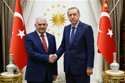 This handout picture taken and released by the Turkish presidential press office Sunday shows Turkish President Recep Tayyip Erdogan, right, shaking hands with the new chairman of Turkey's ruling Justice and Development Party and Minister of Transport, Maritime Affairs, and Communications, Binali Yildirim, left, during a meeting at the presidential complex in Ankara.