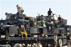 Iraqi security forces gather on the outskirts of Fallujah as they prepare an operation aimed at retaking the city from the Islamic State group on Sunday.