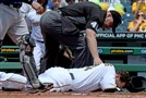 Ryan Vogelsong lies on the ground after being hit in the face by a Jordan Lyles pitch today at PNC Park.