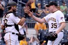 Francisco Cervelli congratulates Mark Melancon after getting a save against the Rockies Monday at PNC Park.