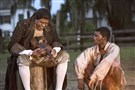 "From left, Fiddler (Forest Whitaker) and Kunta Kinte (Malachi Kirby) star in ""Roots."""