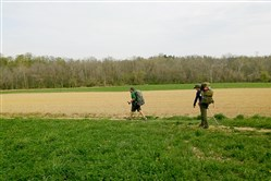 ​Thru-hikers Tom Spies, left, of Lee, Mass., and Mike Marchand, of Courtice, Ontario, hike on farm fields just south of Boiling Springs, where the Appalachian Trail was relocated in the early 1990s.