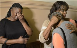 Janene Hays, left, a cousin of Allen Wade, covers her face as she weeps while her sister Sharlene Hayes embraces their mother, Jeanette Howard, after the verdict.