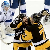 Chris Kunitz celebrates his go-ahead goal against the Lightning with Evgeni Malkin in the second period of Game 5 of the Eastern Conference final Sunday at Consol Energy Center.