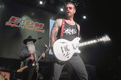 Dave Catching, left, and Jesse Hughes of Eagles of Death Metal perform during the Sweetlife Festival at Merriweather Post Pavilion on May 14 in Columbia, Md.