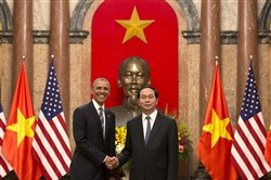 President Barack Obama and Vietnamese President Tran Dai Quang shake hands Monday at the Presidential Palace in Hanoi. Mr. Obama is on a weeklong trip to Asia as part of his effort to pay more attention to the region and boost economic and security cooperation.