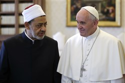 Ahmed Mohamed el-Tayeb, grand imam of Al-Azhar Mosque, talks with Pope Francis during a private audience in the Apostolic Palace at the Vatican on Monday.