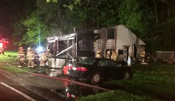 Firefighters on the scene of an overnight house fire on Old Coal Hollow Road in Penn Hills.