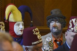 "Ron ""Jingles"" Wassel, of Creighton, Pa., and John ""Hissie"" Hisiro of Charleori wait for the start of Tuesday's hearing. Mr. Wassel works with the the Shriner's Circus."